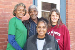 Shown (left to right) in front of the Mount Hope Community Center are its Director Anita Grant, Paul Fore, Jeryll Clark and Barbara Whitehair.