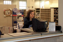 "Mount Hope resident Tina Burgess works at the Post Office. She said, ""I love it here. There are lots of good people in our community."""