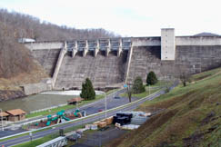 The Sutton Lake project was authorized by Congress in the Flood Control Act of 1938. Construction began in October 1949, but was interrupted by the Korean War. Work restarted in 1956 and in the dam was finally completed in 1961. The facility is managed by the Army Corps of Engineers.