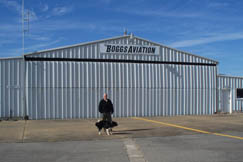 "Richard Boggs is shown at Boggs Aviation, a family owned private airfield with a 4,550 foot runway where light to medium jets can land or take off. ""I've been in aviation since I was 16 years old,"" said Mr. Boggs. ""My father Harry C. Boggs and our family made a group effort to provide an airport in Roane County. It took us 10 years to develop."" The company provides crew and corporate air management for companies that own planes. The airport has fuel and maintenance service, hangar space and flight training. For more information call Boggs Aviation at 304-927-4045."