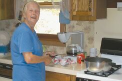 "A ""Buffalo Gal"", Carolyn Short is cooking chili for a rummage sale that will raise money for the Buffalo Creek & Gauley Railroad's campground project."