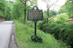 This historic marker shows where the first Golden Delicious apple tree grew.