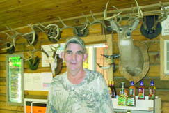 Karl Browning, owner of Ruth's Carry Out shows off the trophies of deer he has killed.