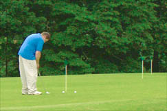 This golfer practices putting at Sandy Brae Golf Course.