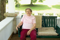 """Hollene """"Tootsie"""" Morris enjoys the afternoon on her porch swing."""