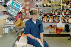 Norman Johnson inside his chain saw dealership.