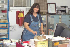 Deanna Robinson welcomes customers to the Kincaid Post Office.