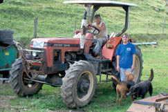 "Merlin and Vicky Shamlin enjoy living in the country with their dogs ""Dana"" (Black & Tan Hound) and ""Dog"" (Black Shepherd Mix)."