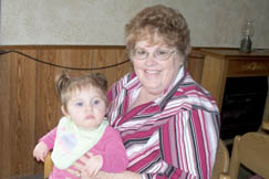 Gracie Holley, holding her granddaughter Shelby, has worked at The Korner since 1990.