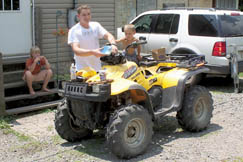 This young father gets help from his son to tune up their ATV