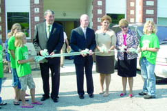 The Grand Opening of Valley Fork Education Center was held on Saturday, Aug. 15, 2009. Adults shown (left to right) are: WV Delegate David Walker (D-Clay), KVCTC President Dr. Joe Badgley, CAEZ Executive Director Connie Lupardus, and WV Department of Education and the Arts Cabinet Secretary Kay Goodwin. The young ladies holding the ribbon are members of the Clay County 4H volunteer team who assisted with the ribbon cutting, flag raising and other tasks at the Grand Opening event.